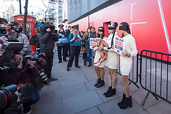 © Licensed to London News Pictures. 15/02/2019. LONDON, UK. Animal rights activists stage a protest outside the British Fashion Council space at 180 The Strand on the opening day of London Fashion Week.  Designers from around the world will be showing their Autumn and Winter (AW19) creations at a variety of venues in the capital.  Photo credit: Stephen Chung/LNP