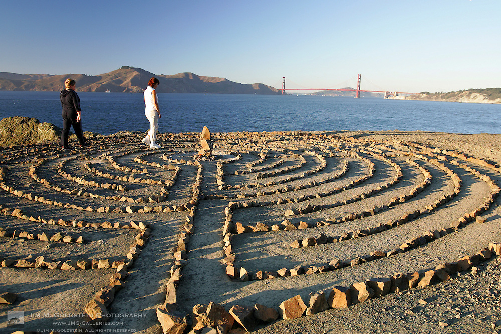 Two women walk through the Lands End Labyrinth at sunset - San Francisco, California