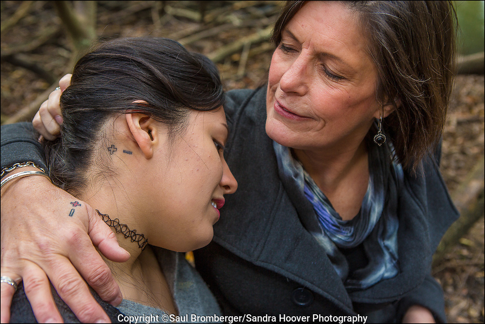 Portrait of the AIDS Generation --<br /> Angelica Tome, left, who is HIV Negative, with her mother Patti Radigan, a long term HIV survivor, in San Francisco, CA