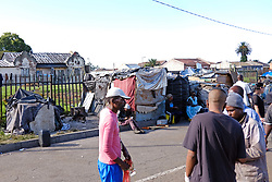 JOHANNESBURG, SOUTH AFRICA - APRIL 12: Homeless, unemployed and families living below the bread line gather in Pageview, to meet Shareef and his team who handed out a total of 300 food parcels on April 12, 2020 in Johannesburg South Africa. Under pressure from a global pandemic. President Ramaphosa declared a 21 day national lockdown extended by another two weeks, mobilising goverment structures accross the nation to combat the rapidly spreading COVID-19 virus - the lockdown requires businesses to close and the public to stay at home during this period, unless part of approved essential services. (Photo by Dino Lloyd)