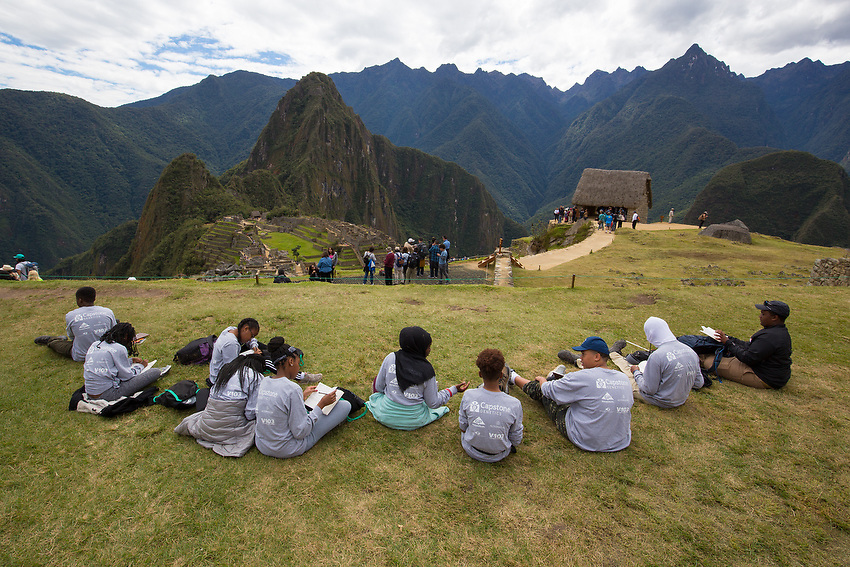 The ancient city of Machu Picchu is seen as the kids take in the beauty and write in their journals.