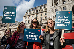 © Licensed to London News Pictures. 15/09/2018. London, UK. Demonstrators at a rally outside The Royal Exchange in the City of London to mark the 10th anniversary of the financial crisis. Photo credit: Rob Pinney/LNP