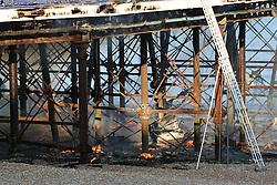 © Licensed to London News Pictures. 30/07/2014. Eastbourne, UK A fire has broken out on Eastbourne Pier this afternoon, 30th July 2014. Firefighters, police, coastguards and lifeboat crews are at the scene after a fire was discovered in a wall panel of an arcade at the front of the Victorian structure. Photo credit : Hugo Michiels/LNP