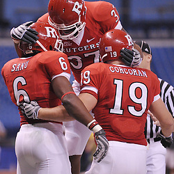 Dec 19, 2009; St. Petersburg, Fla., USA; Rutgers wide receiver Mohamed Sanu (6) celebrates his touchdown run with fullbacks Andres Morales (37) and Jack Corcoran (19) during NCAA Football action in Rutgers' 45-24 victory over Central Florida in the St. Petersburg Bowl at Tropicana Field.