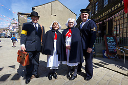© Paul Thompson licensed to London News Pictures. 15/05/2015. Haworth, West Yorkshire, UK. Early arrivers at Haworth 1940s weekend, an annual event in which people dress in period costume and visit the village of Haworth to relive the 1940s. Photo credit : Paul Thompson/LNP