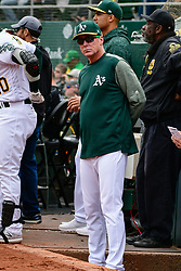 April 18, 2018 - Oakland, CA, U.S. - OAKLAND, CA - APRIL 18: Oakland Athletics Manger, Bob Melvin checks on the outfield during the game between the Chicago White Sox verses the Oakland Athletics on Wednesday, April 18, 2018 at O.co Stadium in Oakland, CA (Photo by Douglas Stringer/Icon Sportswire) (Credit Image: © Douglas Stringer/Icon SMI via ZUMA Press)