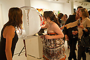 LAUREN MEZZINA; ; ANNA ABRAMOVICH; WITH PETROC SESTI'S WORK ,  Private view and Summer party for Scream Now. An exhibitio of new work by gallery artists. Bruce French,, Derrick Santini, Greg Miller, Malgosia Stepnik, Pakpoom Silaphan, Petroc Sesti, Russell Young. Scream. Bruton st. London. 4 August 2011. <br /> <br />  , -DO NOT ARCHIVE-© Copyright Photograph by Dafydd Jones. 248 Clapham Rd. London SW9 0PZ. Tel 0207 820 0771. www.dafjones.com.