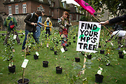 Extinction Rebellion climate change activists bring in small trees and invite MPs to come an collect one tree each as sites around Westminster are blocked on 8th October 2019 in London, England, United Kingdom. Extinction Rebellion is a climate group started in 2018 and has gained a huge following of people committed to peaceful protests. These protests are highlighting that the government is not doing enough to avoid catastrophic climate change and to demand the government take radical action to save the planet.