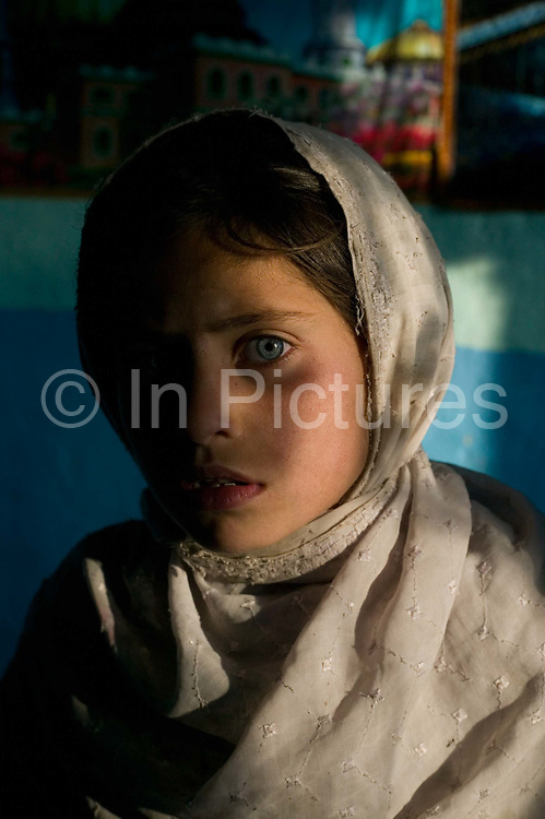 The daughter of Noor Agha showing some of the look of Sharbat Gula the girl made famous by Steve Mc Curry's photograph  that featured on the cover of National Geographic in 1985.