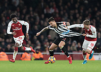 Football - 2017 / 2018 Premier League - Arsenal vs. Newcastle United<br /> <br /> Nacho Monreal (Arsenal FC) pulls the shirt of Joselu (Newcastle United) to prevent him breaking away at The Emirates.<br /> <br /> COLORSPORT/DANIEL BEARHAM