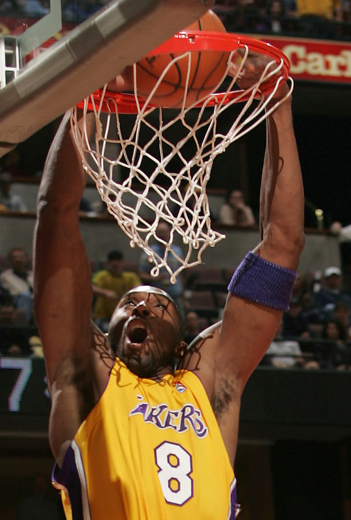 The Los Angeles Lakers' Kobe Bryant dunks against the Utah Jazz in exhibition basketball at the Arrowhead Pond of Anaheim Tuesday October 25, 2005.