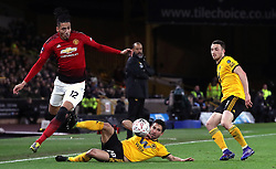 Manchester United's Chris Smalling jumps over a challenge from Wolverhampton Wanderers' Joao Moutinho during the FA Cup quarter final match at Molineux, Wolverhampton.