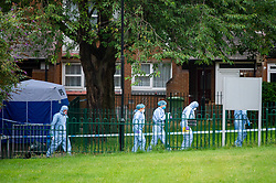 © Licensed to London News Pictures. 04/07/2020. London, UK. Investigators walk away from a forensic tent on Westbourne Estate in Islington. Metropolitan Police Service officers were called at 15:20BST on Saturday, 4 July to Roman Way N7 following reports of shots fired. Officers attended with London Ambulance Service (LAS) and found a man, believed to be aged in his early 20s, suffering from gunshot injuries. Despite their best efforts, he was pronounced dead at the scene. Photo credit: Peter Manning/LNP