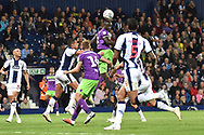 Bristol City striker Famara Diedhiou (9) gets up-highest to head at goal during the EFL Sky Bet Championship match between West Bromwich Albion and Bristol City at The Hawthorns, West Bromwich, England on 18 September 2018.