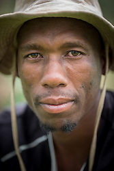 "3 March 2017, Thaba Bosiu, Lesotho: Farmer David Moshoeshoe is 33 years old. He lives on the hillside of Thaba Bosiu, ""Night Mountain"" in Thaba Bosiu, Lesotho, where he grows vegetables, mainly cabbage and spinach. Thaba Bosiu is a sandstone plateau some 24 kilometers east of Lesotho's capital, Maseru. The name means Night Mountain, and surrounding the plateau is a small village and open plains. Thaba Bosiu was once the capital of Lesotho, and the mountain was the stronghold of the Basotho king when the kingdom of Lesotho was formed."