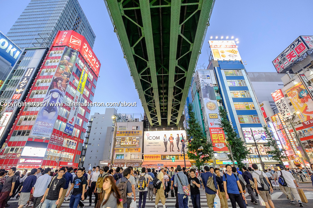 Busy pedestrian crossing in Akihabara known as Electric Town or Geek Town selling Manga based games and videos in Tokyo Japan