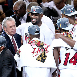Jun 21, 2012; Miami, FL, USA; Miami Heat president Pat Riley celebrates with small forward LeBron James (6) and other players after winning the 2012 NBA championship against the Oklahoma City Thunder at the American Airlines Arena. Miami won 121-106. Mandatory Credit: Derick E. Hingle-US PRESSWIRE