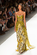 Gown with a yellow and black anmal print skirt and Fortuny-style pleated top.  By Carlos Miele at the Spring 2013 Mercedes-Benz Fashion Week in New York.
