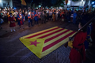 A Catalan flag lies on the flore at El Fossar de les Moreres  moments before the commemoration. During the parade, held the day before the Catalan national day, Catalan separatist protests asking freedom for politicians arrested after the unilateral referendum held almost a year ago. Barcellona, Spain, September 10, 2018. Federico Scoppa