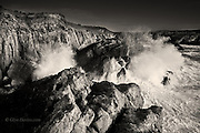 Big Irish Sea storm waves slam against the limestone cliffs of Rhoscolyn Head, North West Anglesey
