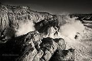 Big Irish Sea storm waves slam against the limestone cliffs of Rhoscolyn Head, North West Anglesey