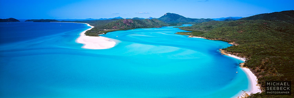 An aerial panoramic photograph of Whitehaven Beach and the glorious aqua waters of Cook Inlet, in the Whitsundays.<br /> <br /> Code: HAQW0011<br /> <br /> Limited Edition Print