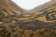 A patchwork of small cultivated fields and shepherd's huts and stone corrals in a valley along the trail to the community of the Q'eros, high in the Cordillera de Paucartambo, Andes Mountains, Peru. The Q'eros, a Quecha people, are considered the last direct descendants of the Incas and proudly maintain many of their ancient traditions. Most Q'eros live at higher elevations during the dry season to herd alpaca, but potatoes and other staples are grown at these lower elevations (~ 11,000 feet).