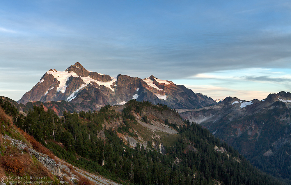 Post sunset view of Mount Shuksan, Huntoon Point on Kulshan Ridge, and the sloped on the south side of Table Mountain.  Photographed in the fall from the Chain Lakes Trail in the Mount Baker Wilderness, Washington State, USA.