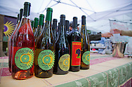 The Portland Farmers' Market in the South Park Blocks on Saturday mornings.  Arcane Cellars offers wine tasting at the Saturday Farmers' Market.  Jeff and Jason Silva (father and son) are the vintners.  Neil is an employee and oversees the wine tasting at the market.  Tasters are artist Eric Gibbons and Elizabeth Pedinotti.