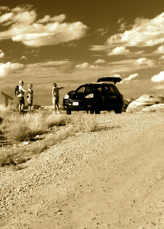 Our Porsche Cayenne, in addition to being a daily driver, is used as Porsche intended.  We explore dirt roads of the back county and camp in remote locations.  Here, we are in the Canyonlands National Park of southern Utah and Carol is directing a couple of hikers back to their campsite.
