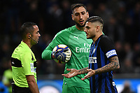 Referee Marco Guida debates with Mauro Icardi of Internazionale as Gianluigi Donnarumma of AC Milan  look at them during the Serie A 2018/2019 football match between Fc Internazionale and AC Milan at Giuseppe Meazza stadium Allianz Stadium, Milano, October, 21, 2018 <br />  Foto Andrea Staccioli / Insidefoto