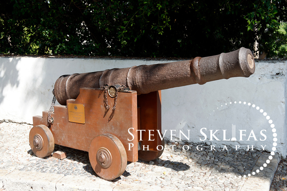 Kos Town. Old canon at the Square of Hippocrates. Two cannons are positioned at the entrance to the connecting bridge to the castle of the Knights of St John. Kos is part of the Dodecanese island group and birthplace of the ancient physician and father of medicine, Hippocrates.