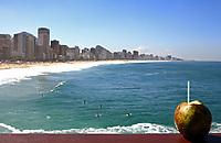 agua de coco national drink in font of beautiful ipanema Leblon beach in rio de janeiro brazil