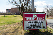 A no trespassing sign is at the entrance to the former Ashland State General Hospital.