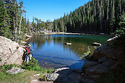 A fisherman at Dream Lake in Rocky Mountain National Park, Colorado