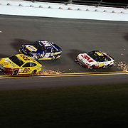 Joey Logano (22), Martin Truex Jr. (56), Greg Biffle (16),  Dale Earnhardt Jr. (88) and Carl Edwards (99) are seen in turn four of the NASCAR Sprint Unlimited Race at Daytona International Speedway on Saturday, February 16, 2013 in Daytona Beach, Florida.  (AP Photo/Alex Menendez)