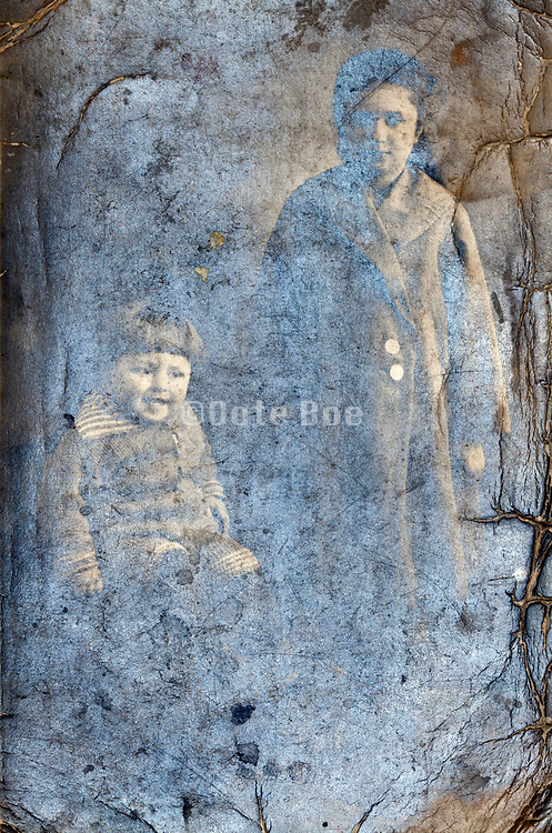 deteriorating studio portrait of toddler with a teenaged girl