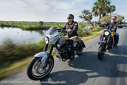Andrea Labarbara (foward) riding her Roland Sands RSD custom with her husband Bob Zeolla on his custom Harley-Davidson on a ride through Tomoka State Park during Daytona Beach Bike Week, FL. USA. Friday, March 15, 2019. Photography ©2019 Michael Lichter.