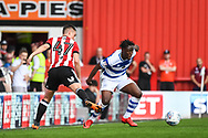 Queens Park Rangers Defender Osman Kakay (29) dispossess Brentford Forward Sergi Canos (47) during the EFL Sky Bet Championship match between Brentford and Queens Park Rangers at Griffin Park, London, England on 21 April 2018. Picture by Stephen Wright.