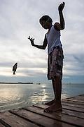 Fisher boy<br /> Caye Caulker<br /> Ambergris Caye<br /> Belize<br /> Central America<br /> Caye Caulker receiving Station<br /> Northern Fisher cooperative