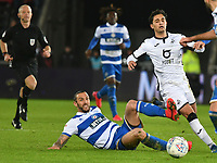 Football - 2019 / 2020 Sky Bet (EFL) Championship - Swansea City vs. Queens Park Rangers<br /> <br /> Yan Dhanda of Swansea City  tackled by Yoann Barbet of QPR, at The Liberty Stadium.<br /> <br /> COLORSPORT/WINSTON BYNORTH