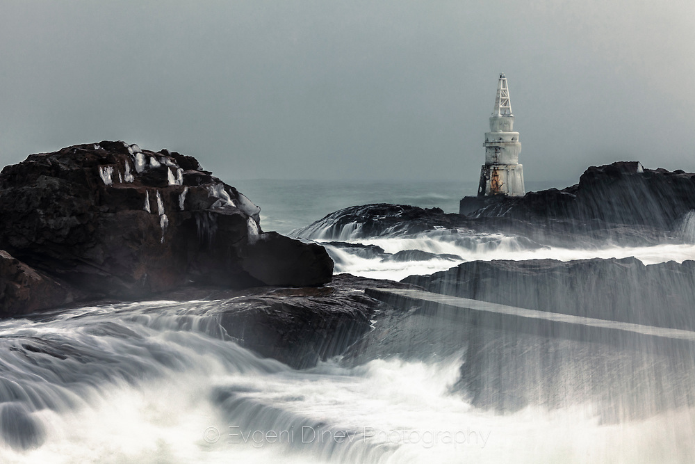 Stormy winter sea with big waves, smashing in the rocks