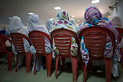 Ladies attending the first-ever international Conference on Womens' Challenge in Darfur, listen to speeches in a compound belonging to the Govenor of North Darfur in Al Fasher (also spelled, Al-Fashir) where the women from remote parts of Sudan gathered to discuss peace and political issues.