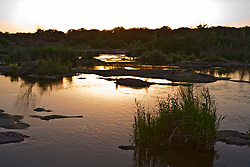 Stock photo of sunset along the banks of the Llano River in the Texas Hill Country