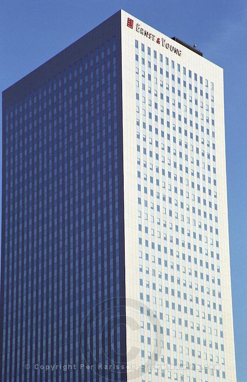 Modern skyskraper office buildings at La Defense complex. Ernst and Young building. Paris, France.