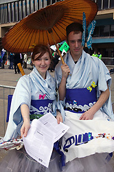 Friends of the Earth supporters wearing makeshift kimonos during protest,