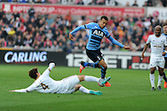 Dele Alli of Tottenham Hotspur is tackled by Ki Sung-Yueng of Swansea city. Barclays premier league match, Swansea city v Tottenham Hotspur at the Liberty Stadium in Swansea, South Wales on Sunday 4th October 2015.<br /> pic by  Andrew Orchard, Andrew Orchard sports photography.