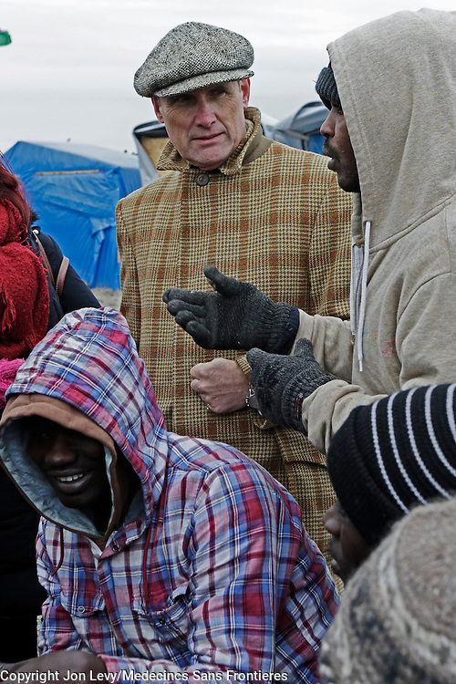 Writer AA Gill talks with refugees from Darfur, Sudan, in the refugee camp in Calais France. <br /><br /><br />Calais: AA Gill visits the refugee camps of Calais and Grande Synthe in Dunkirk.
