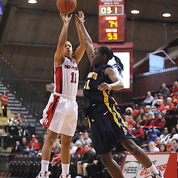 Jan 18, 2009; Piscataway, NJ, USA; Rutgers guard Nikki Speed (11) scores on a last second shot during the second half of Rutgers' 76-53 victory over Marquette at the Louis Brown Athletic Center.