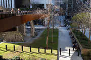 While office workers remain at home in accordance to government Covid guidelines and individual corporate policies, some Londoners enjoy warm spring sunshine beneath Bassishaw Highwalk in the City of London, the capital's financial district, during the third lockdown of the Coronavirus pandemic, on 9th March 2021, in London, England.